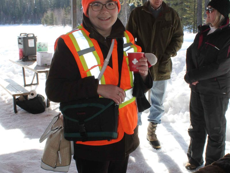 woman enjoying hot chocolate at winter hiking day