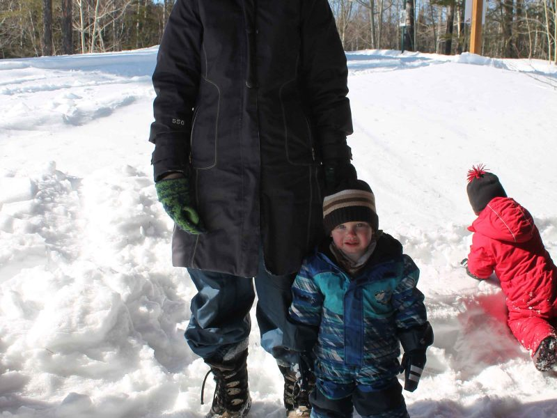 mom and two children enjoying Wintergreen's winter hiking day