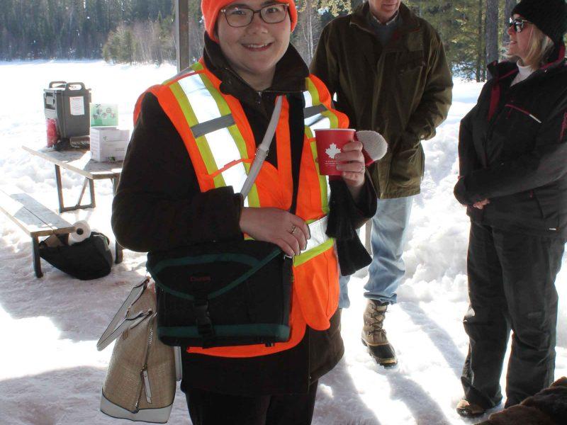 woman enjoying hot chocolate at winter hiking day