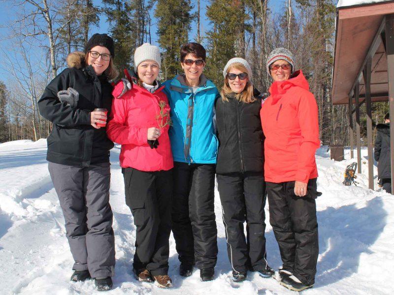 group of people enjoying winter hiking day