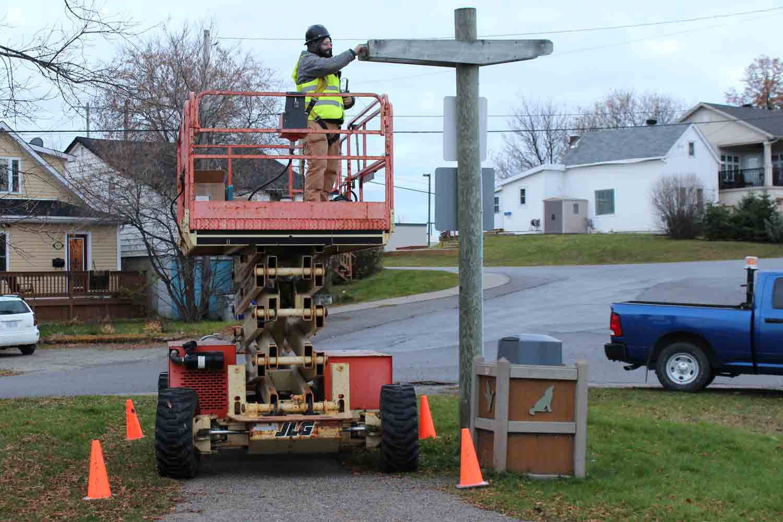 Worker installing LED lights in outdoor lightposts