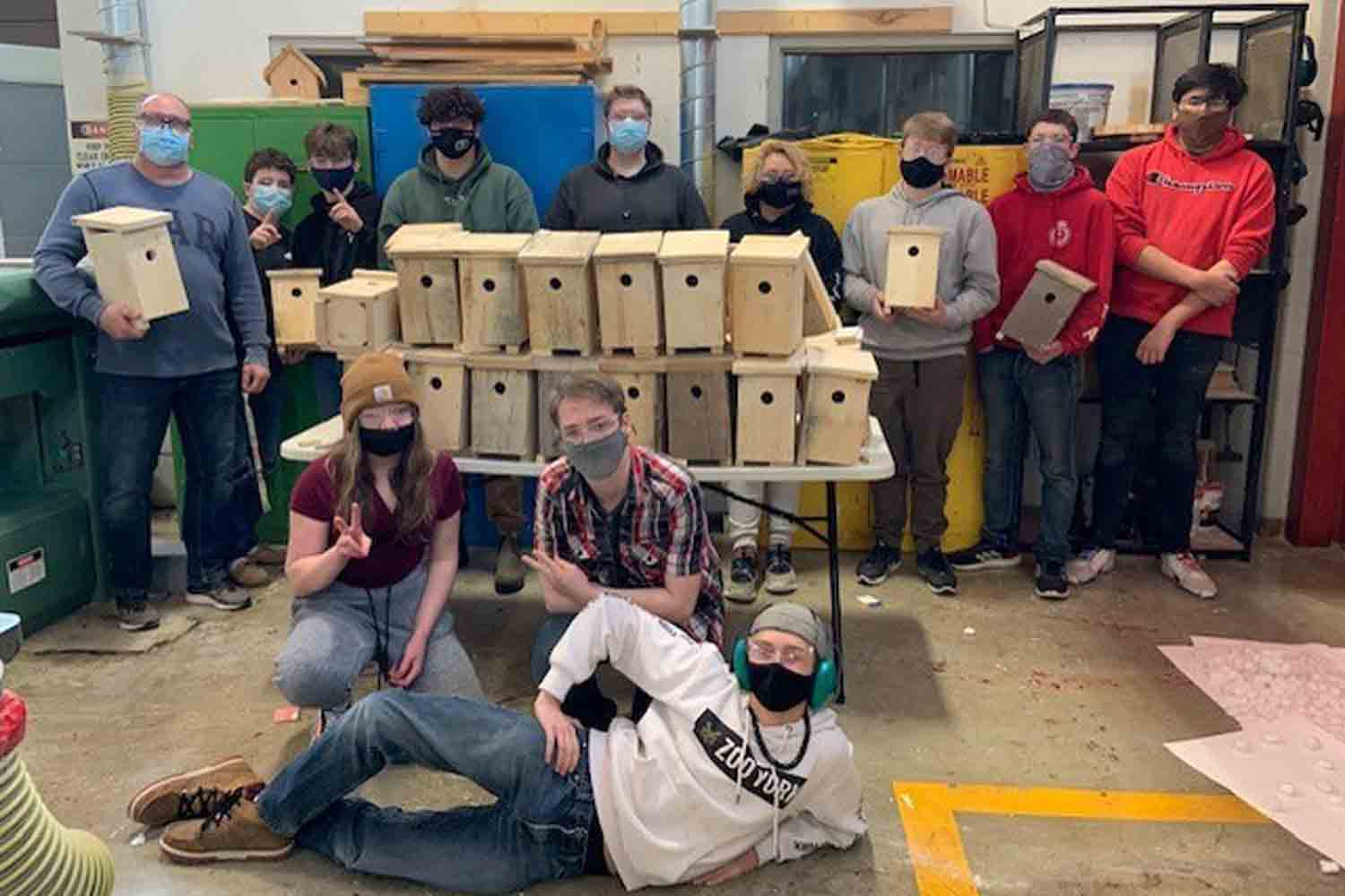 Timmins High and Vocational School class with the swallow boxes they built